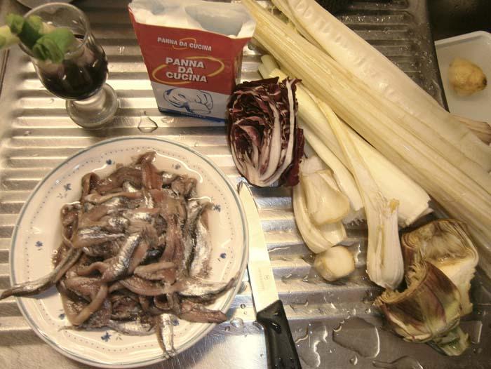 Preparare le acciughe e le verdure
